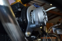 Rear alternator bracket and alternator installed - bottom view.