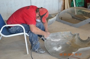 Sanding the cowling for fitting to the firewall.